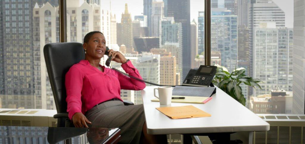 Amata-Chicago-Attorney-Lady-Calling-on-the-Phone-In-Her-Private-Office-Bold-Patents