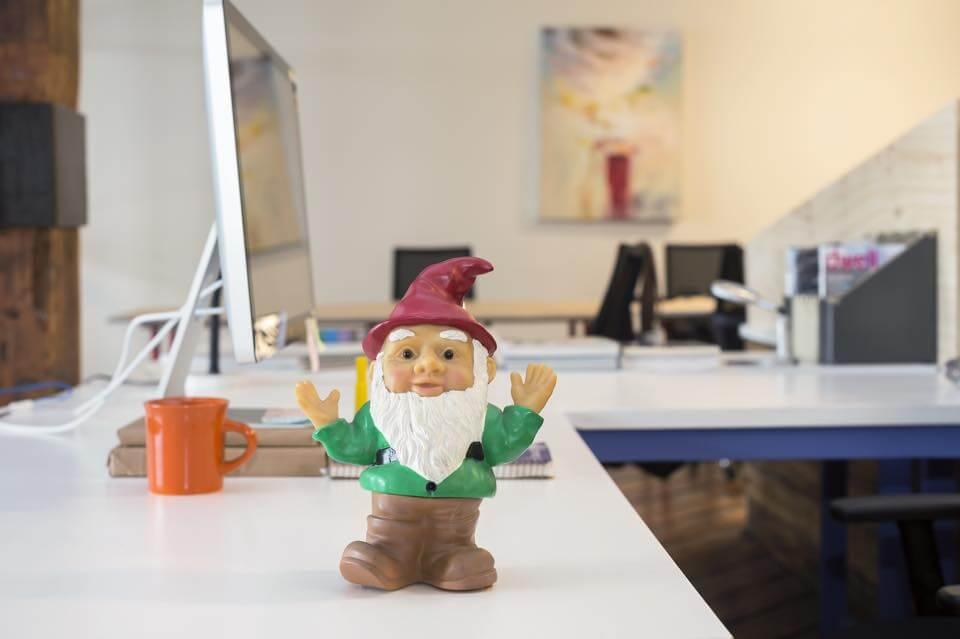 Shared-Brooklyn-Coworking-Bold-Patents-Room-Gnome-On-top-of-White-Desk
